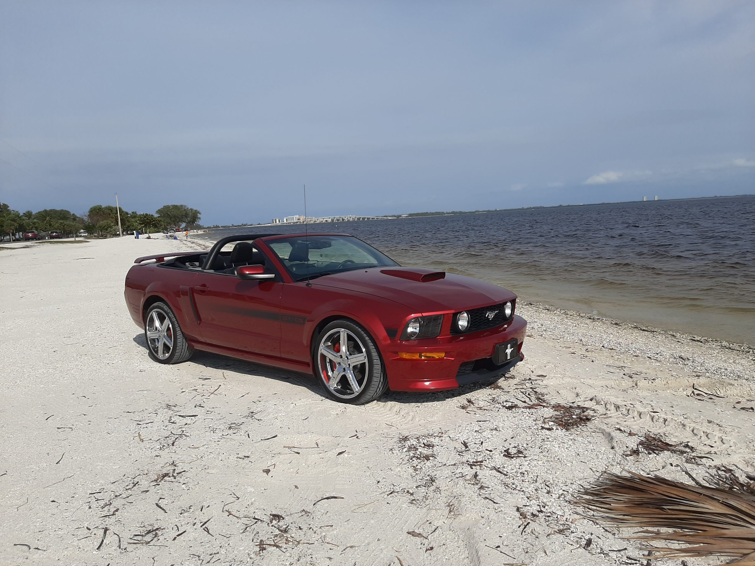 Red 2007 Mustang GT/CS Convertible on the beach