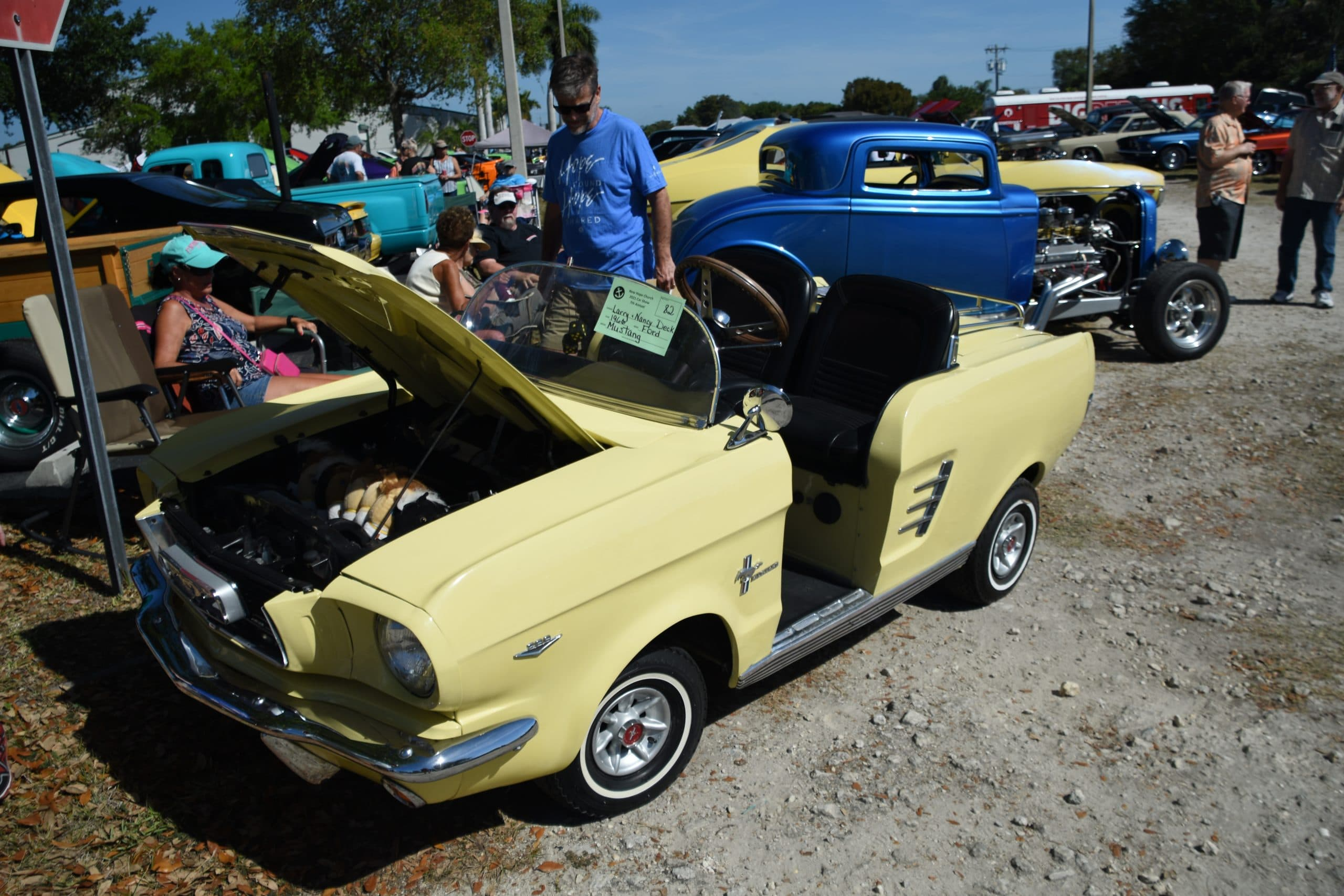 Yellow Golf cart designed to look like a mustang