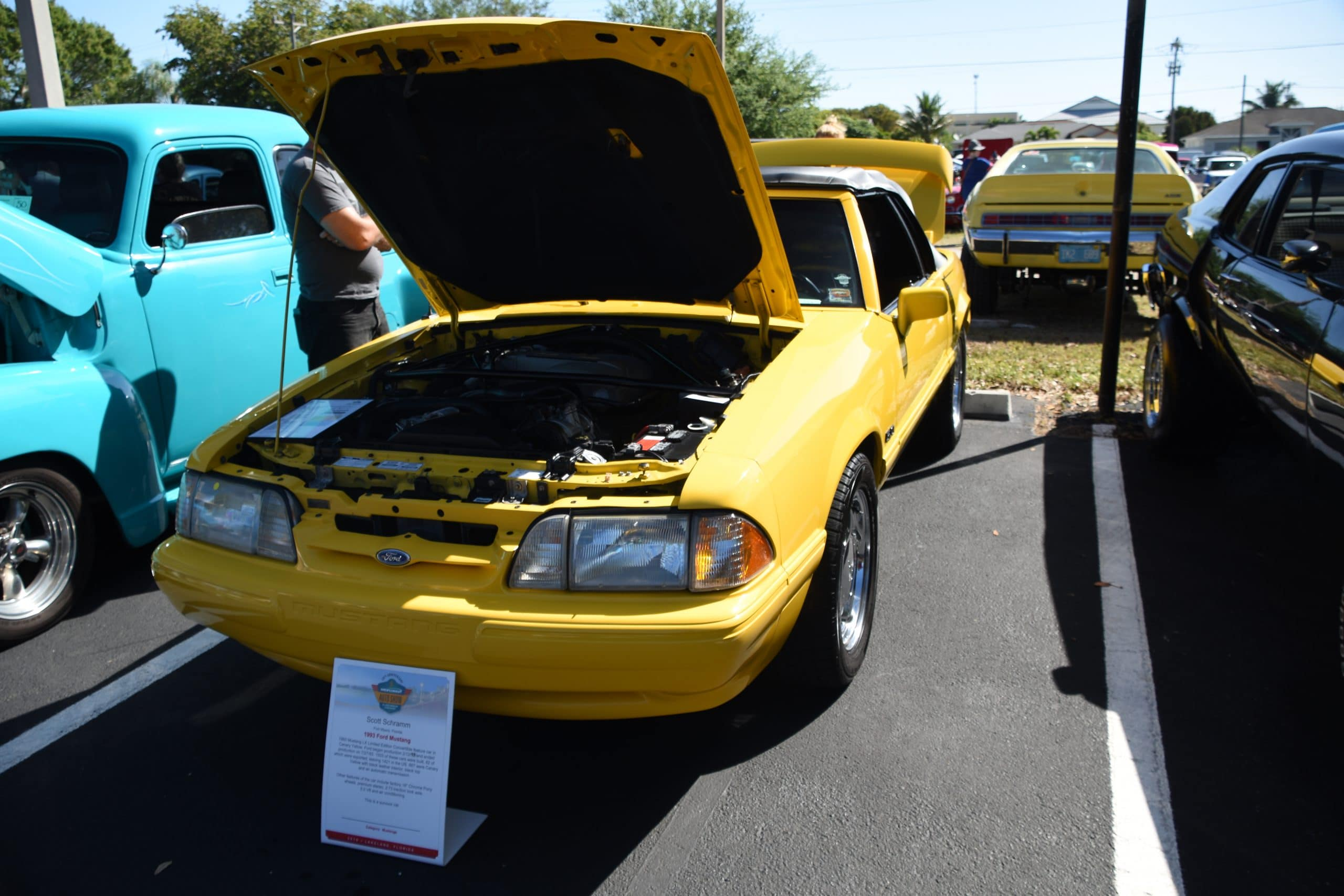 Yellow Mustang GT with hood up