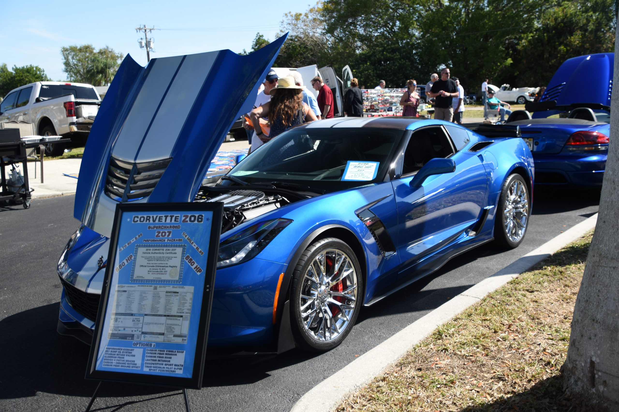 Blue Corvette with hood up