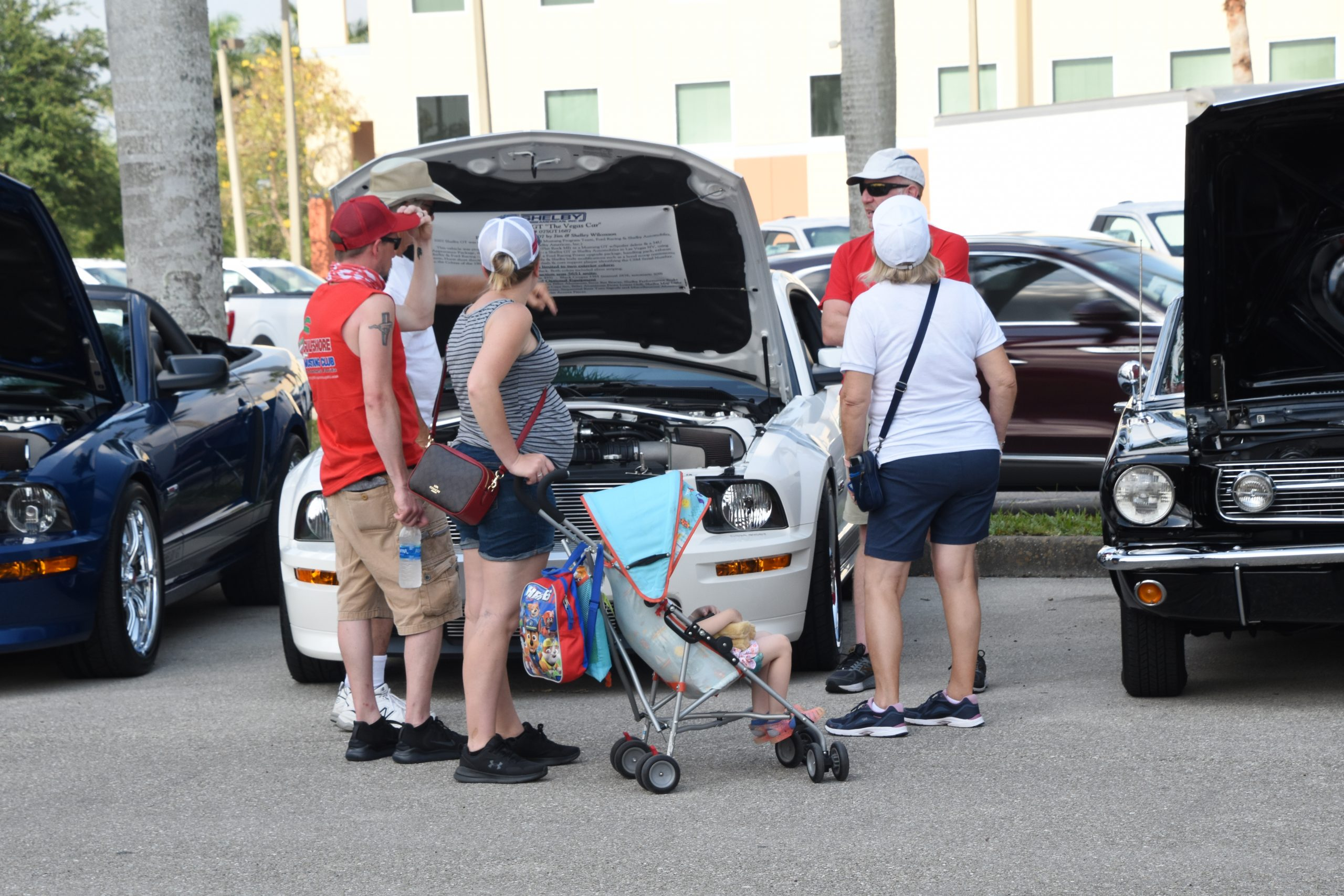 Family viewing a mustang