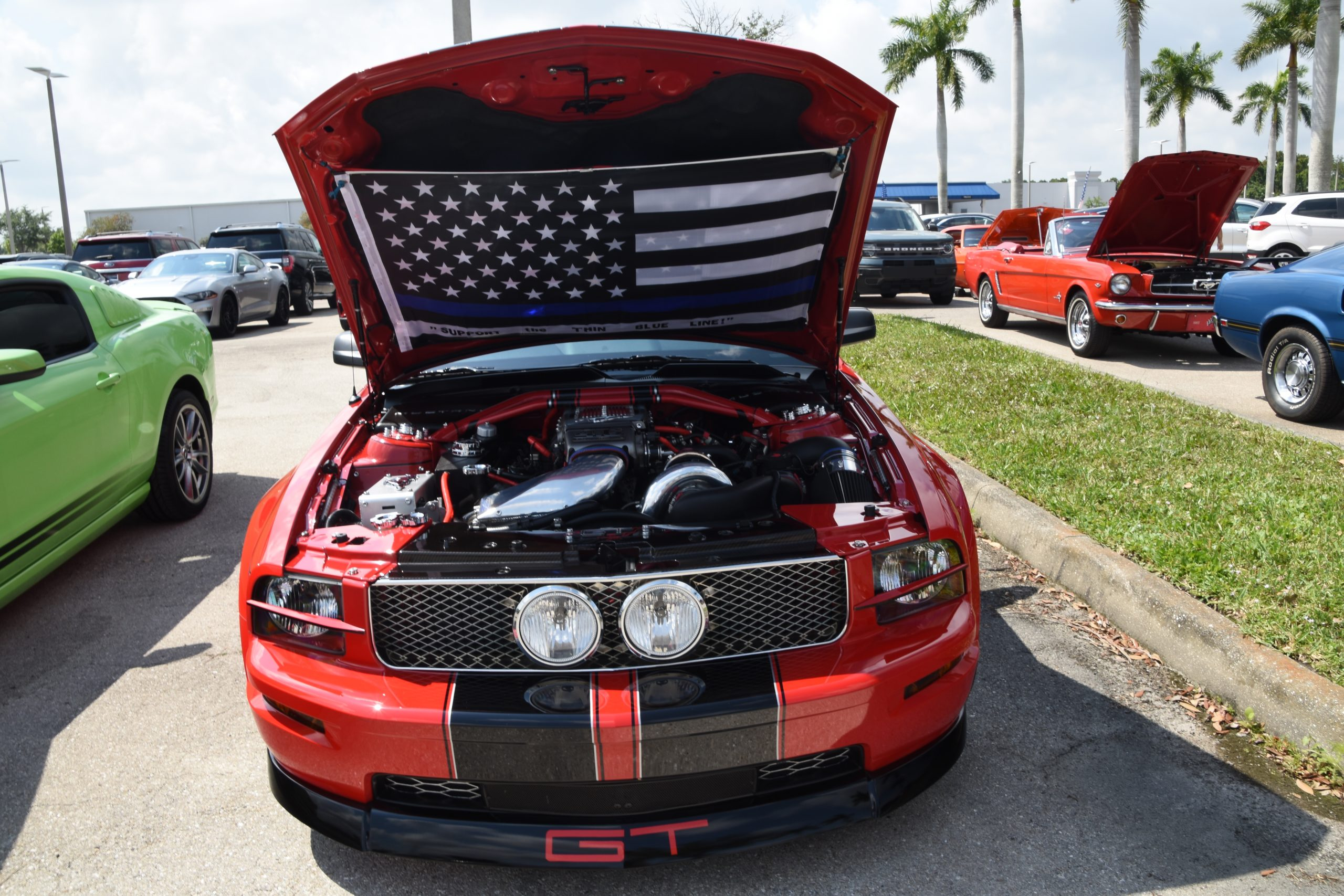 Red Mustang GT with hood up