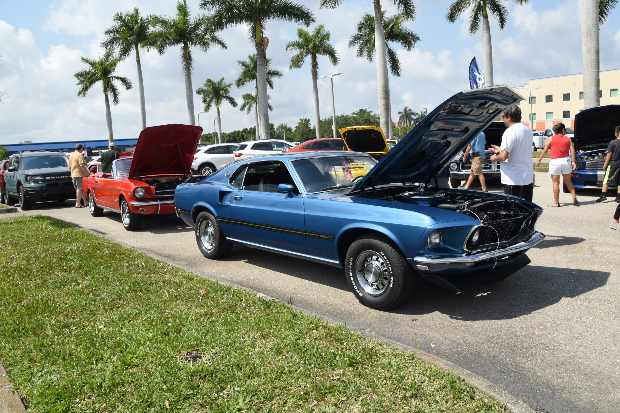 Blue Mustang with hood open