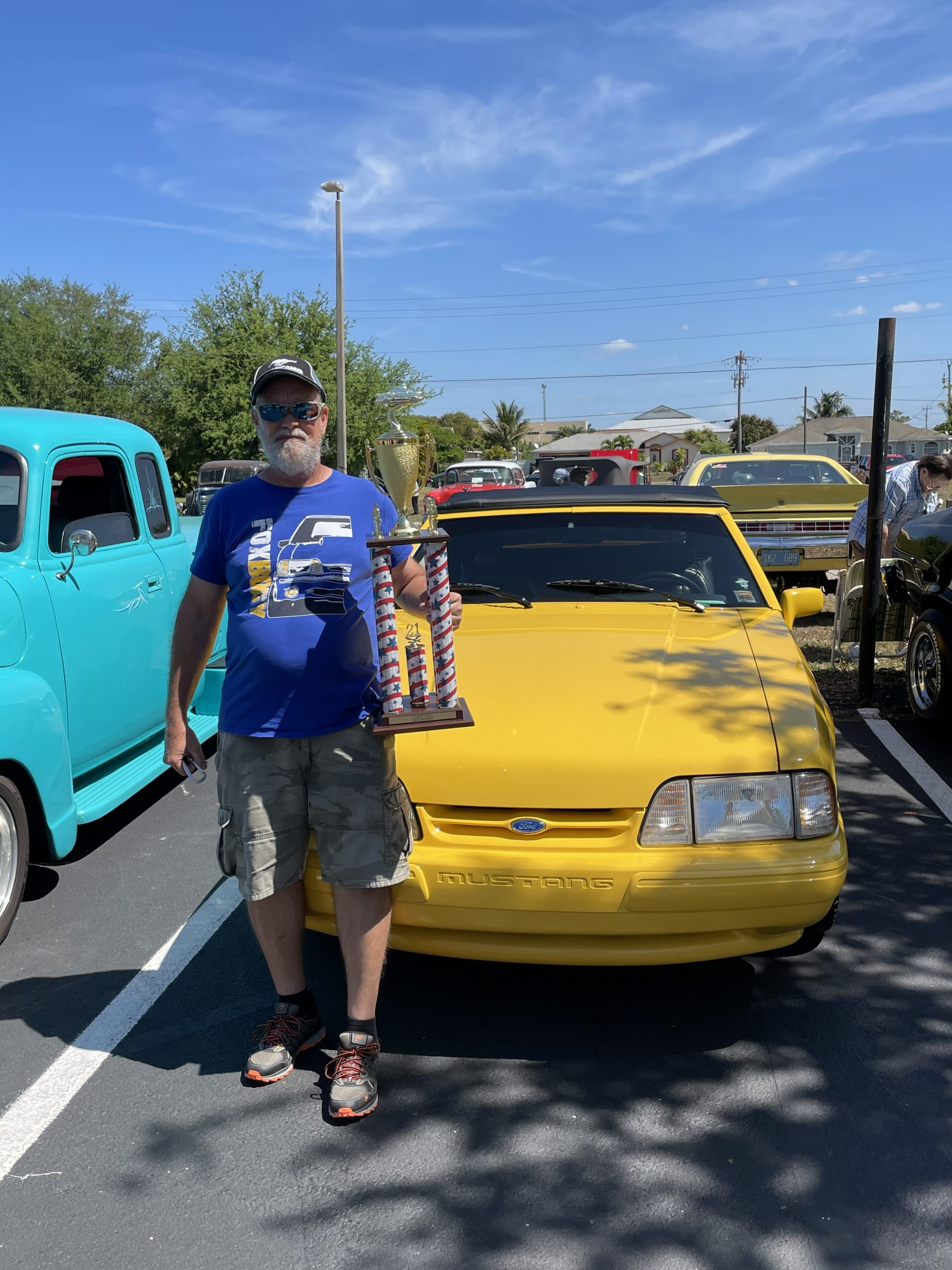GSMC Club Member with trophy in front of Car